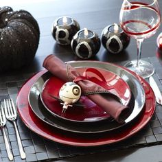 The Nightmare before Christmas style wedding.  with rich reds and black. awesome table setting idea