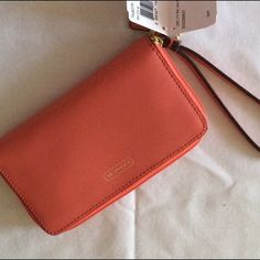 NWT Coach Saffiano leather wristlet. Brand new and never used.  Bought this also for myself and never used!!!  Perfect for a phone wristlet and has interior card pockets. Coach Bags Clutches & Wristlets