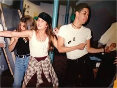His name is Wilson Cruz shown Dancing with Rayanne Graff:) These are behind the scene's photo's of My So Called Life a 90's teen drama. They were uploaded to twitter for throwbackthursday.