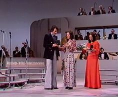 Eurovision Song Contest 1973 . winner ceremony with singer Anne Marie David, composer Claude Morgan and previous year winner Vicky Leandros