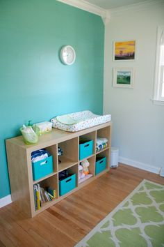 Interesting way to do a nursery shelf (expedit shelving, ikea)