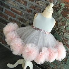 baby girl party dresses Gray satin bodice rose goldsequin waistbandlayeredpink tulle with pom pom ruffle detail on hem Lined for added comfort Don't see what you need?CUSTOM OR Girls Frock Design, Kids Frocks Design, Baby Frocks Designs, Baby Dress Design, Kids Gown Design, Baby Girl Frocks, Frocks For Girls, Cheap Flower Girl Dresses, Little Girl Dresses
