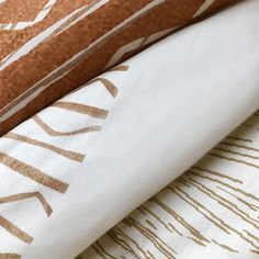 With its giant golden and copper medallion motifs and clean white background, our Maluhia Duvet Cover is a real attention grabber.  #home #homedecor #decor #decoration #interior #interiordesign #interiordesigner #bedroom #bed #kitchen #bath   #bathroom #furniture #diy #dining #livingroom #gift #gifts #giftideas #quilts #pillows