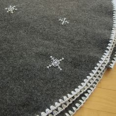 Snowflake Christmas Tree Skirt by katbaro, via Flickr