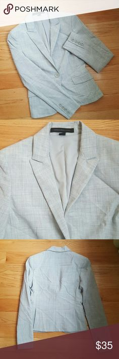 Express Gray Blazer Perfect addition to your professional wardrobe. Single button closure- decorative front flap pockets- double vented back. Padded shoulders. Excellent pre-loved condition. Express Jackets & Coats Blazers