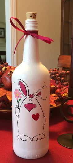 Learn how to Make Easter Wine Bottle Crafts - Castle Random bottle crafts spring Wine Bottle Glasses, Wine Bottle Art, Glass Bottle Crafts, Painted Wine Bottles, Lighted Wine Bottles, Decoration St Valentin, Garrafa Diy, Easter Paintings, Wine Craft