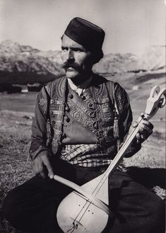 The gusle (Albanian: lahuta, Croatian: gusle, Serbian: гусле, pronounced [ɡûsle]) is a primitive single-stringed musi. History Of Photography, Portrait Photography, Warrior Priest, Les Balkans, Serbia And Montenegro, Merle, Instruments, Folk Clothing, Chant