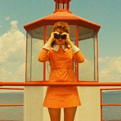 ELLE loves... fashion inspiration from Wes Anderson film, Moonrise Kingdom Suzy Bishop (played by Kara Hayward) looks cute in a 60s style long sleeved, yellow mini dress with a white collar. Perfectly accessorised with a pair of vintage binoculars. Click through for more colourful Wes Anderson movie stills!