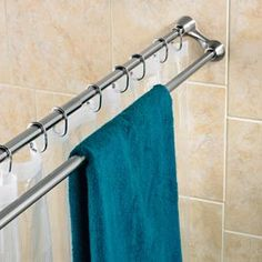 Duo Shower Curtain Rod 2-in-1 space-saver! Use one rod for the shower curtain, the other for towels. So need this!