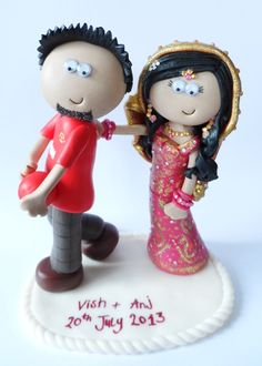 Manchester United loving Groom, traditionally dressed Indian Bride trying to stop him going to watch football! www.googlygifts.co.uk for your own.
