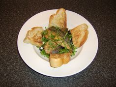 Pan Fried Mackerel Fillets with Feta Cheese Stuffed Olives and Peashoots Salad