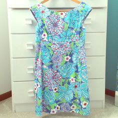 Lilly Pulitzer blue flower dress Lilly Pulitzer blue flower dress. I believe the pattern is called May Flower but I'm not sure. Great condition. Size 4. Lilly Pulitzer Dresses Mini