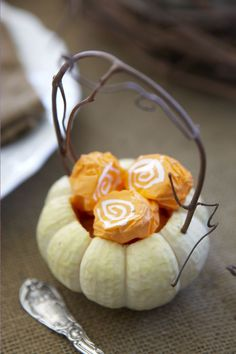 Fall wedding -   Easy enough to do:  Use a knife to cut open the top, then scoop out the insides.  Make the handle with a bendable vine or branch from outside.  Pierce a tiny hole breaking the gourd skin and push in the vine to hold. Then add mini bread buns for your table!