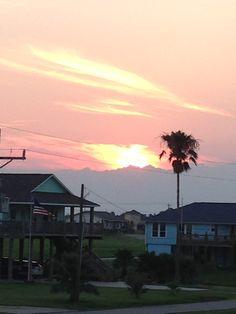 Sunset toward intercoastal waterway.  Taken from back deck of Barefoot Escape vacation rental in Crystal Beach, TX