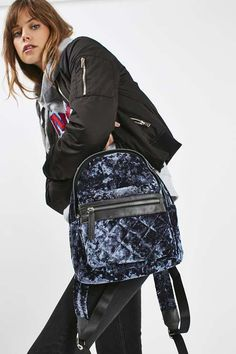 Both ways practical and stylish, the backpack is the trending bag of the season. We love this style in blue velvet with a practical front pocket. A mini size, use this bag to store your main essentials. #Topshop