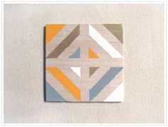 This tut is for coasters, but this would look awesome on the wall too. Make a ton of them and hang them up in a grid pattern - Cute!