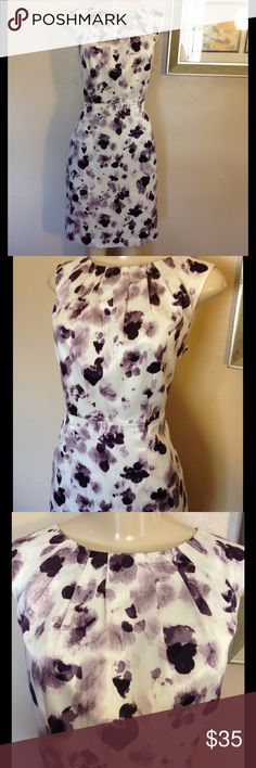 "Ann Taylor Dress Beautiful dress in white, plum, and lavenders. Zipper in back and fully lined.  Size is 8 Petite. Measures 18"" bust, 15 1/2"" waist, 19 1/2"" hips, 36"" length.   Bundle and save. No holds and no trades. Please use offer to negotiate. Ann Taylor Dresses"
