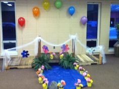 Bridge My husband created for our bridging ceremony. Made from 3 nice Pallets and a 4th one we used for spare parts. Add a blue tablecloth surround with 6 for $1 plastic pots and some dollar store flowers along with badges earned to make border for water, some white tulle, 6 helium balloons and a couple of wind spinners. This is what you come up with. i think at most we spent $15.00 on the whole project and It looked so amazing we have kept it to use every year.