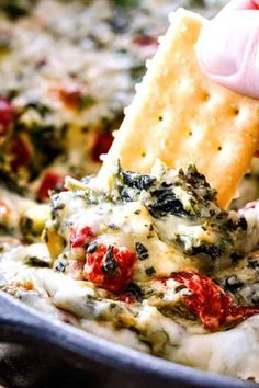 Brie Spinach Dip - my friends could not get over this appetizer! Its your favorite spinach dip made even more delicious with BRIE! Creamy, cheesy and so addicting!