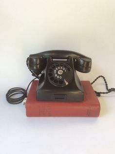 Vintage rotary phone. Black bakelite phone. Ericsson phone.