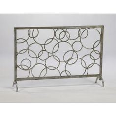 Modern Open Circles Fireplace Screen. This would actually match the artwork I have on the wall already.