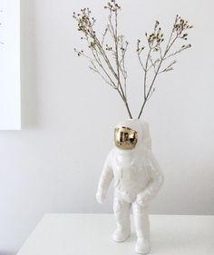 Porcelain Astronaut Vase http://shop.thecoolhunter.net/product/cosmic-porcelain-astronaut-vase/