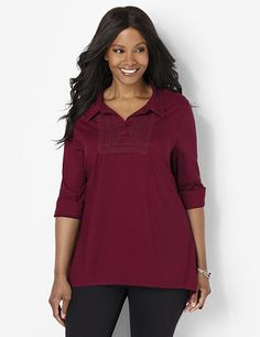 This extra-long tunic pairs perfectly over our leggings for an instantly slimming look. A lovely, embroidered applique accents the surplice necklace. Cozy cotton style comes in your choice of solid colors. Long sleeves feature pleats and button cuffs, with additional buttons at the upper arm and elbow for a convertible, three-quarter sleeve style. Complete with an asymmetrical hem that falls to flattering points at each side. Catherines tops are perfectly proportioned for the plus size…