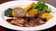 Grilled Duck Breast with a Confit Duck Neck Sausage