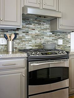 I like the color of these cabinets - especially with the backsplash and stainless steel appliances. 10 Kitchen Trends Here to Stay - recycled glass tile backsplash Centsational Girl Updated Kitchen, New Kitchen, Kitchen Decor, Green Kitchen, Kitchen Tile, Kitchen Colors, Ugly Kitchen, Kitchen Walls, Stylish Kitchen