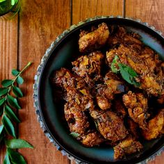 Spicy Indian Chicken Roast, chicken cooked and slow roasted in the pan flavored with spices and curry leaves.