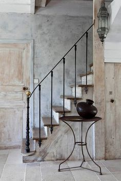 Patina on the walls - Simple but elegant iron banister and railing - Would look nice in either an older more traditional home, a loft conversion, or a more contemporary home