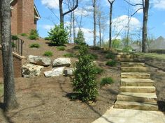 front yard stone walkways | Found on peachlandhomes.com