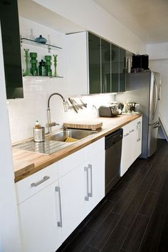 BoHolmen Ikea sink with drainboard, wooden countertops, and solid faucet.