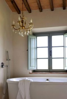 simple chandelier over the bath tub