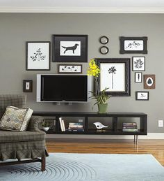 Give Your Wall Decor Meaning - note the tv tucked away within the wall art - clever!   - My Kirklands Blog