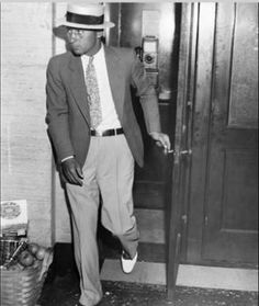 """Jack """"Machine Gun"""" McGurn is seen leaving a phone booth in Chicago, ca 1920. McGurn, a longtime henchman of Al Capone's Chicago operation."""
