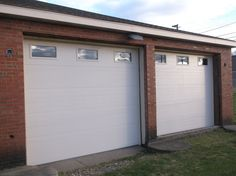 CHI 3285 Garage Doors In Almond Color With Windows Top Section