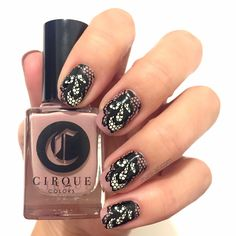 Reverse-stamped manicure using Cirque Colors' Jane on Jane St., Carpe Diem, MoYou London's Black Knight and Fashionista Plate 17.