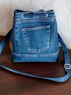 Billedresultat for recycle jeans Upcycled denim jeans bag - pinning for inspiration - item is/was for sale. Dimensions - height diameter of the bottom - shopping bags from old jeans pic for inspiration purpose only, links to site to purchase from maker 71 Denim Tote Bags, Denim Handbags, Denim Purse, Jean Purses, Purses And Bags, Mochila Jeans, Denim Ideas, Denim Crafts, Recycle Jeans