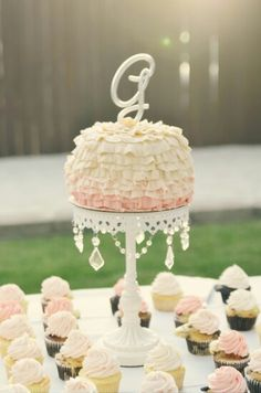 Vintage wedding cake and cupcakes. Love the simple beauty of this.  Eatmyfrosting. Com