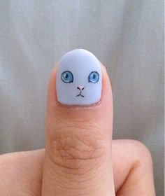 A little kitty on your thumb nail will keep you happy when you are lonely! This is so easy to create! Use a toothpick for the small details, such as the nose and pupils and a dotting tool for the eyes!