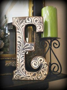 Another pretty letter...with pretty raised design in the finish...these make great décor.