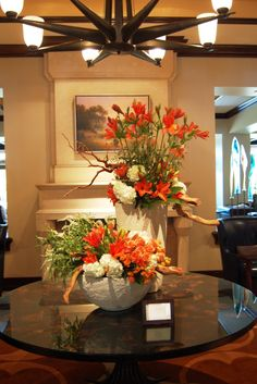 "Our lobby floral arrangement screams ""HOOK EM"" in honor of UT graduation weekend! *The Flower Studio"