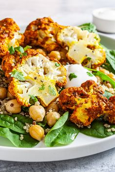 This tandoori gobi is a vegan take on the classic Indian recipe. Cauliflowers are roasted with a spicy yogurt sauce and served with a nutritious salad. tandoori gobi,tandoori roasted cauliflower,cauliflower roast indian recipe,marinated cauliflower indian recipe,yogurt roasted cauliflower #vegan #govegan #dairyfree #glutenfree #recipe #cooking #food Low Sugar Recipes, No Sugar Foods, High Protein Recipes, Tandoori Marinade, Tandoori Paste, Tasty Vegetarian Recipes, Pescatarian Recipes, Healthy Recipes, Indian Cauliflower
