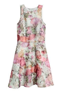 Knee-length, sleeveless dress in a patterned weave with a fitted bodice and concealed zip at the back. Seam at the waist and gently flared skirt. Lined.