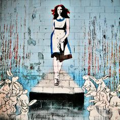 Bansky - Alice  I really like Bansky's take on Alice with all the rabbits around her.