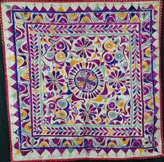Purple embroidered floss silk central flower, surrounded by embroidered foliage, 74cm x 76cm  http://worldbasket.co.uk/product-category/antique-and-vintage-textiles/