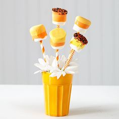 Melt, dip, and dry are the basic steps to enjoy these delightful marshmallow pops: http://www.bhg.com/halloween/recipes/halloween-treats-kids-can-make/?socsrc=bhgpin101714candycornmarshmallowpops&page=10