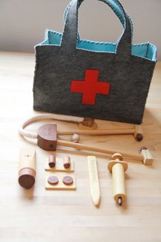 45wall design: felt doctor bag with wooden instruments