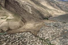 Credit: Rahmat Gul/AP An aerial perspective by Rahmat Gul shows the full extent of the landslide that buried the village of Abi Barik in Afghanistan
